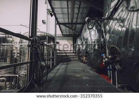 Industrial interior of an alcohol factory with silos