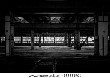 Industrial interior of an old factory building - stock photo