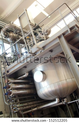 industrial interior, with big iron tank, chemical use  - stock photo