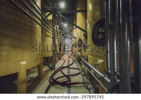 Industrial interior with welded silos angle shot - stock photo