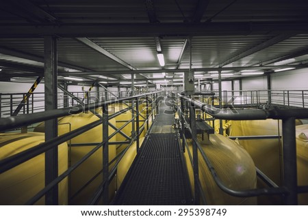 Industrial interior with welded silos from above - stock photo