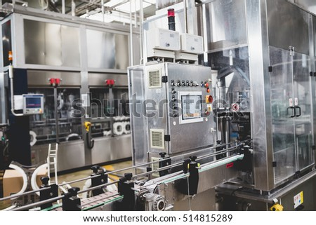 Industrial interiors and machinery. Robotic factory line for processing and quality control of pure spring water bottled into canisters.