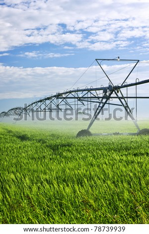 Industrial irrigation equipment on farm field in Saskatchewan, Canada - stock photo