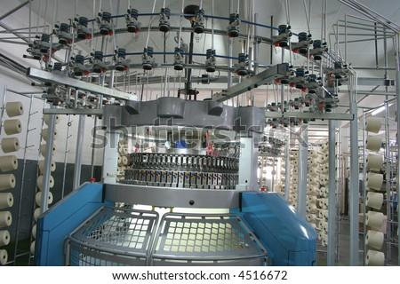 Industrial knitting machine producing cotton yarn - stock photo