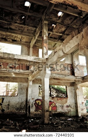 Industrial landscape: abandoned ruins of the factory - stock photo