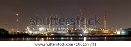 Industrial landscape by night - stock photo