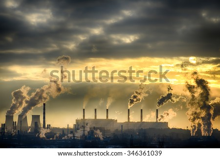 Industrial landscape. From pipe factory smoke, polluting the atmosphere. HDR image