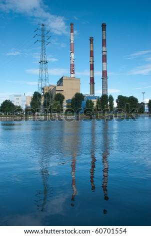 Industrial landscape. Heat station and the river. - stock photo