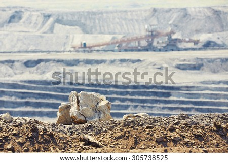 Industrial landscape - huge mining machine in the coal mine - stock photo