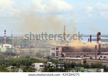 industrial landscape industrial area of Volgograd, smoking chimneys against the blue sky - stock photo