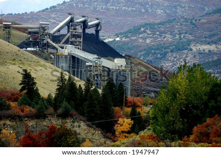 industrial landscape of coal mining infrastructure on side of hill in mountain country - stock photo