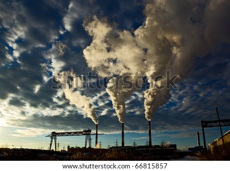 industrial  landscape, sky with clouds, the smoke from the chimneys of thermal power plants - stock photo