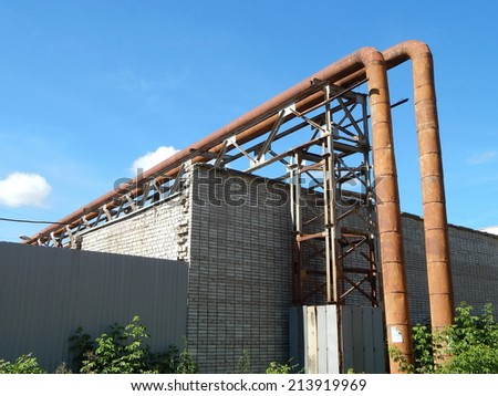 Industrial landscape, the heat pipes - stock photo
