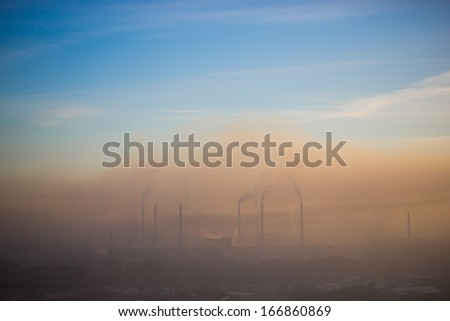 industrial landscape. tube. emits smoke - stock photo