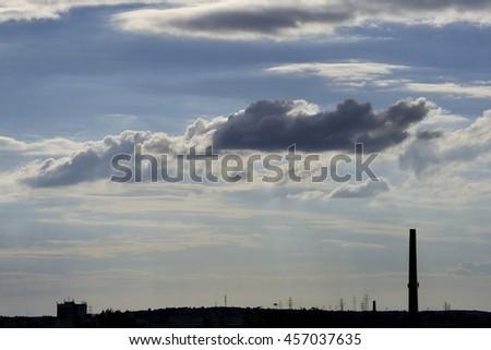 Industrial landscape with dramatic cloud decoration.Landscape format. - stock photo