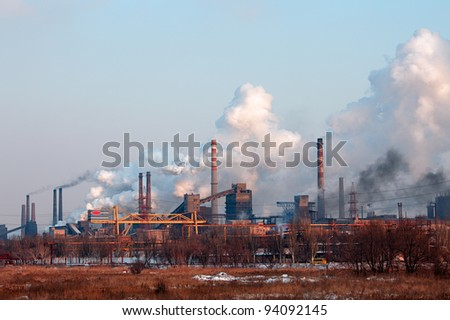 Industrial landscape with factory chimney and smoke - stock photo