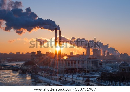 Industrial landscape with thermal power plant during sunrise in Moscow - stock photo