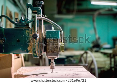 industrial lathe tool, drilling and milling tool, iron drill in action at steel and metal factory - stock photo