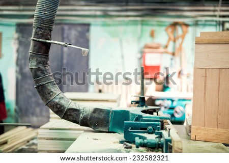 industrial lathe tool, drilling and vacuuming the saw dust from wood processing - stock photo