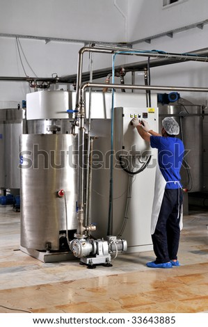 industrial liquid storage tanks and pipes - stock photo