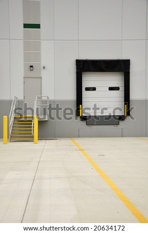 industrial loading dock and stairs for a large warehouse - stock photo