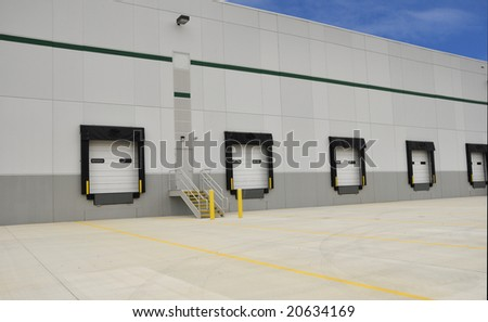 industrial loading docks for a large warehouse - stock photo