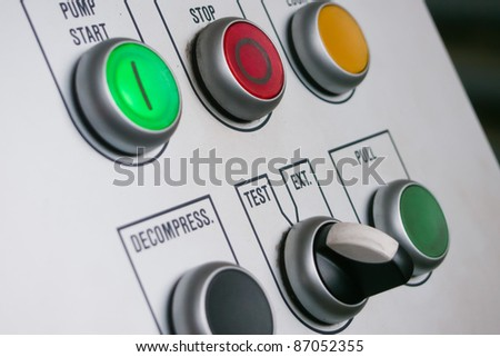 Industrial machine's control panel push buttons - stock photo