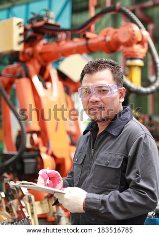 Industrial manufacture, man worker in factory checking and writing on the board checking quality metal - stock photo