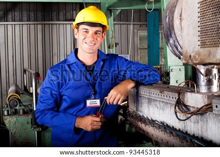 industrial mechanical technician portrait in factory - stock photo