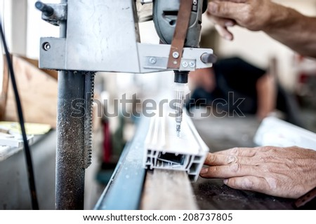industrial metal and steel drilling tools in factory. Metal industrial machines and manufacturing tools - stock photo