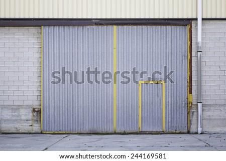 Industrial metal door street construction - stock photo