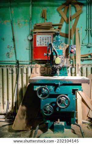 industrial metal drilling tool in factory. Metal industrial machines, production and manufacturing tools - stock photo