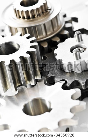 Industrial metal gears and machine parts connected - stock photo