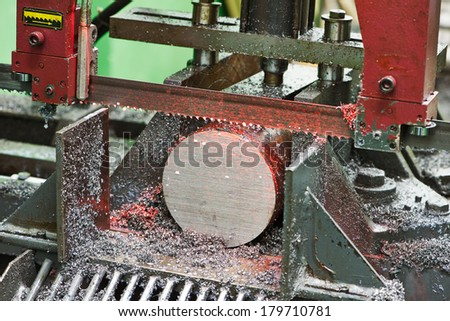 industrial metal saw. industrial metal machining cutting process of blank detail by mechanical electrical saw