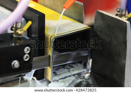industrial metal machining cutting process of blank detail by mechanical electrical saw - stock photo