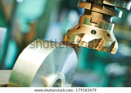 industrial metal machining cutting process of blank detail by milling cutter with hardmetal carbide insert - stock photo