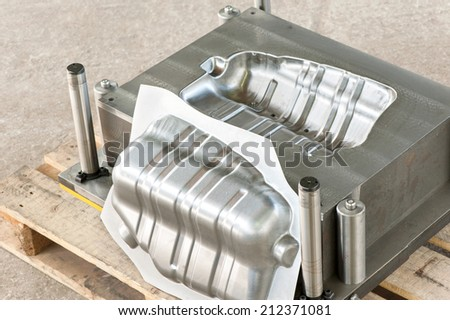 Industrial metal matrix mold make with iron die/blank of muffler. Lathe milling and drilling industry. Mechanical engineering and metalworking. CNC technology. - stock photo