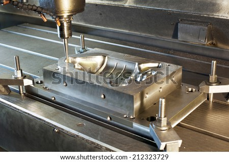 Industrial metal mold/ blank milling. Metalworking and mechanical engineering. CNC technology. - stock photo