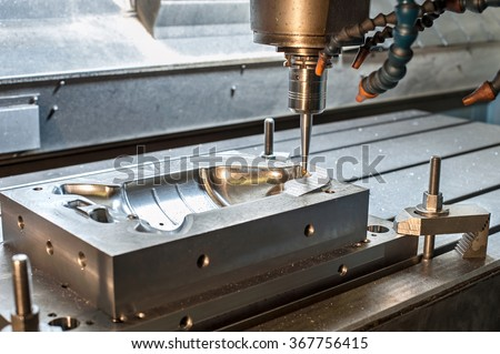 Industrial metal mold/blank milling. Metalworking. Lathe, milling and drilling industry. CNC technology. - stock photo