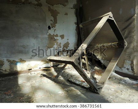 Industrial metal table frame inside abandoned grungy room - landscape color photo