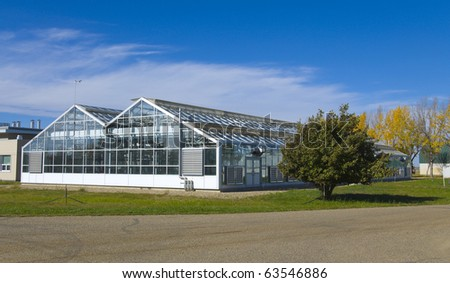 Industrial modern farm, agricultural greenhouse - stock photo