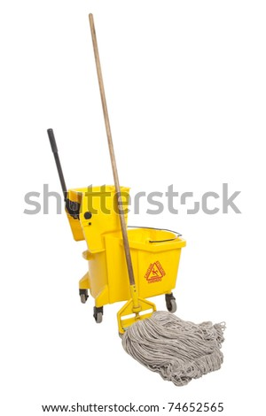 Industrial mop and bucket isolated on white background - stock photo