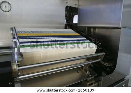 industrial packing machine in production line of factory