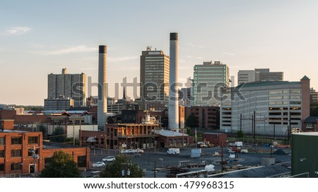 Industrial part of Harrisburg Pennsylvania. Steam electric Power plant in foreground with some highrise motels and businesses behind it.