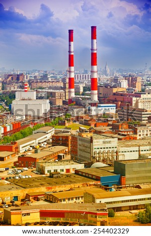 Industrial part of the city - industrial architecture, plants, industrial pipes - stock photo