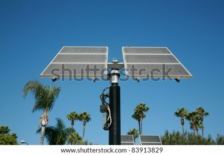 Industrial photovoltaic  cells also known as Solar Power or Solar Cells sit outside harnessing the power from the sun and turning it into free earth friendly electricity for use to run electronics - stock photo