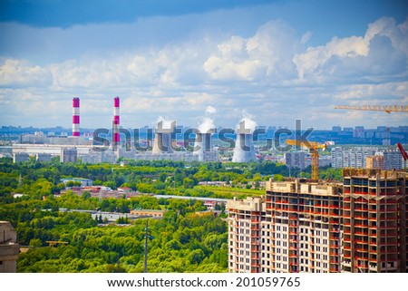 Industrial pipe smoke and construction of the building in the foreground - stock photo
