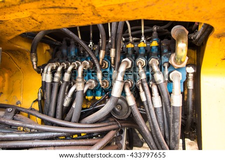 Industrial pipe system of hydraulic valves in an excavator - stock photo