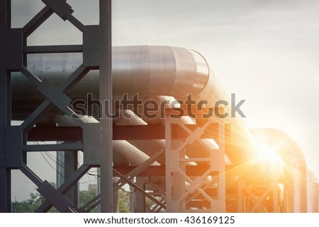 Industrial pipe with gas and oil and water on a sunlight background - stock photo