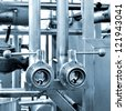 Industrial pipelines and other equipment at the factory - stock photo